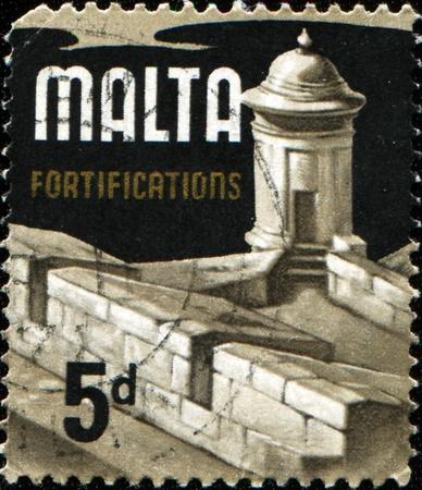 MALTA - CIRCA 1972: A stamp printed in Malta shows Fortress, circa 1972 Stock Photo - 9231644