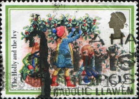 carols: GREAT BRITAIN - CIRCA 1982: A stamp printed in Great Britain shows Carols The Holly and the Ivy, circa 1982  Stock Photo