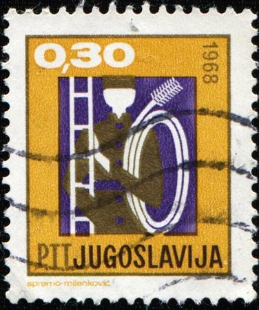 YUGOSLAVIA - CIRCA 1968: A stamp printed in Yugoslavia shows chimney sweep, circa 1968 Stock Photo - 9231665