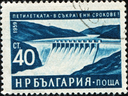 BULGARIA - CIRCA 1959: A stamp printed in Bulgaria honoring Five Year Plan shows Hydro-electric barrage photo
