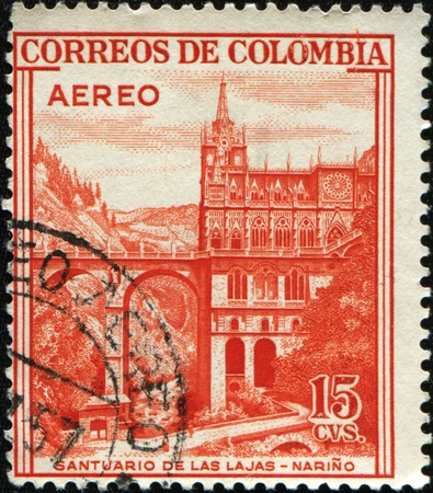 cancelled stamp: COLOMBIA - CIRCA 1954: A stamp printed in Colombia shows Santuario de las Lajas, Narino, circa 1954 Stock Photo