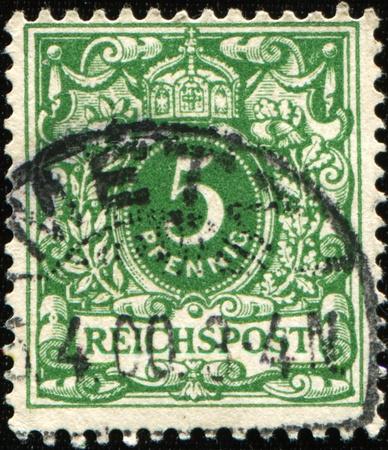 definitive: Alemania - CIRCA 1900: Un sello impreso en Imperio alem�n shows5 Pfennig, serie definitiva de colonias alemanas, alrededor de 1900 Foto de archivo