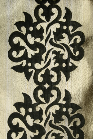 fragment of antique textile with oriental symmetry pattern photo