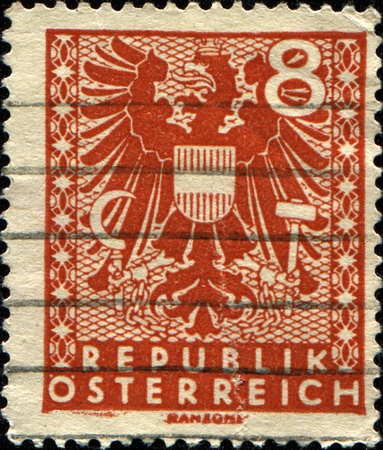 AUSTRIA - CIRCA 1945: A stamp printed in Austria shows New National Coat of Arms, circa 1945 photo