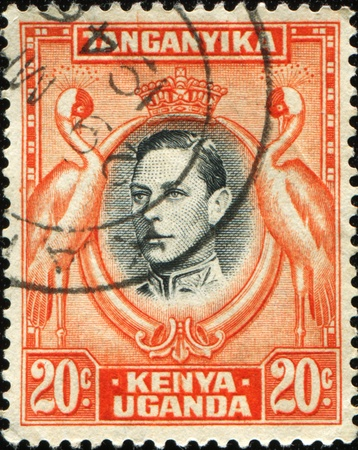 tanganyika: KENYA, UGANDA AND TANGANYIKA - CIRCA 1951: A stamp printed in East Africa shows  medallion portrait of King George V, surrounded of storks, circa 1951