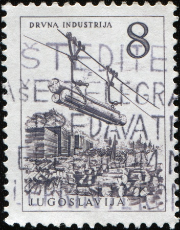 yugoslavia federal republic: YUGOSLAVIA - CIRCA 1958: A stamp printed in Federal Peoples Republic Yugoslavia shows Timber industry, cable railway, circa 1958 Stock Photo