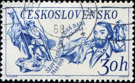 insurrection: CZECHOSLOVAKIA - CIRCA 1968: A stamp printed in Czechoslovakia honoring 120th Anniv of Slovak Insurrection and 25th Anniv of Slovak National Council. M. J. Hurban and Standard-bearer