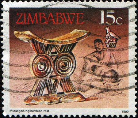 artifacts: ZIMBABWE - CIRCA 1990: A stamp printed in Zimbabwe shows Headrest, Cultural Artifacts, circa 1990