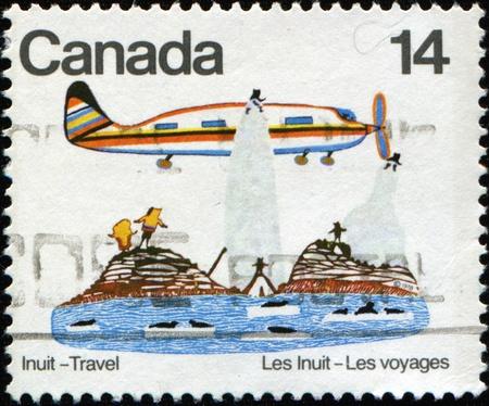 avia: CANADA - CIRCA 1978: A stamp printed in Canada shows Canadian Eskimos (Inuits), Travel, circa 1978