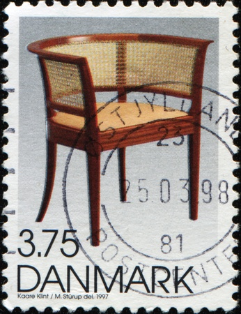 DENMARK - CIRCA 1997: A stamp printed in Denmark shows chair by Kaare Klint Danish architect and furniture designer, circa 1997 Stock Photo - 9430057