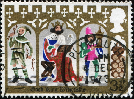 GREAT BRITAIN - CIRCA 1973: A stamp printed in Great Britain shows Good King Wenceslas, the Page and Peasant, circa 1973 photo