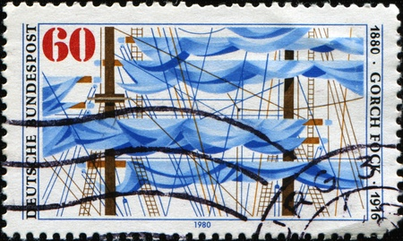 fock: GERMANY - CIRCA 1980: A Stamp printed in the Germany honorimg Gorch Fock was the pseudonym of the German author Johann Wilhelm Kinau shows sail of naval vessels, 1880 - 1916, circa 1980 Stock Photo