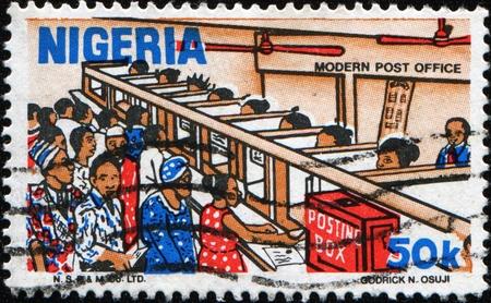 nigeria: NIGERIA - CIRCA 1983: A stamp printed in Nigeria shows Nigerian Life. Post Office counter, circa 1983 Stock Photo