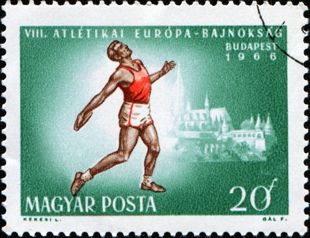 HUNGARY - CIRCA 1966: A stamp printed in Hungary shows discus thrower, circa 1966 photo