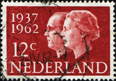 beatrix: NETHERLANDS - CIRCA 1962: A stamp printed in Netherlands honoring Silver Wedding shows Queen Beatrix and Prince Bernhard, circa 1962