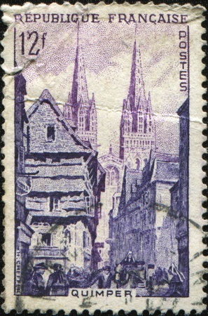 FRANCE - CIRCA 1954: A stamp printed in France shows city of Quimper in Brittany, series, circa 1954 Stock Photo - 9570504