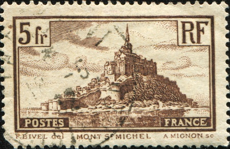 used stamp: FRANCE - CIRCA 1929: A stamp printed in France shows Mont St Michel, circa 1929