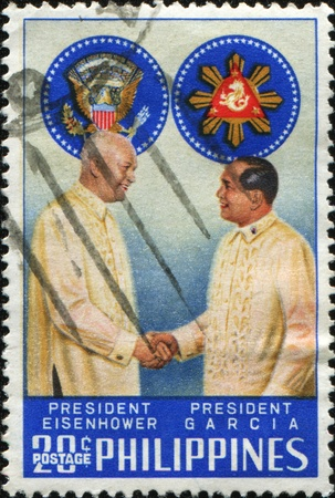 eisenhower: PHILIPPINES - CIRCA 1960: A stamp printed in the Philippines shows President Eisenhower and President Garcia, circa 1960 Editorial