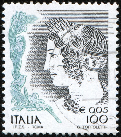 ITALY - CIRCA 1979: A stamp printed in Italy shows Young Etruscan Girl (detail of tomb painting), circa 1979 Stock Photo - 9631343