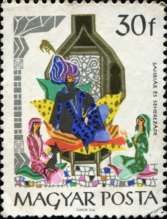 HUNGARY - CIRCA 1965: A stamp printed in Hungary shows Scenes from The Arabian Nights Entertainments. Sultan Schahriah and Scheherazade, circa  1965 Foto de archivo