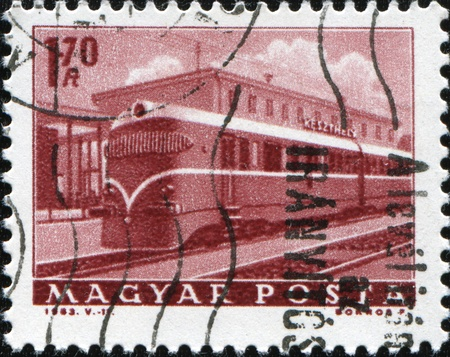 HUNGARY - CIRCA 1963: A stamp printed in Hungary shows electric locomotive on Keszthely station, circa 1963 photo