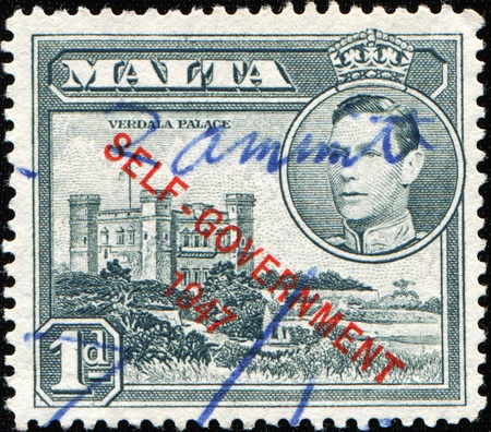 MALTA - CIRCA 1947: A stamp printed in Malta shows Verdala Palace, circa 1947 Stock Photo - 9751281