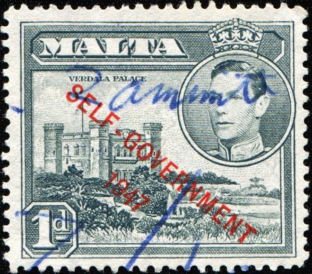 MALTA - CIRCA 1947: A stamp printed in Malta shows Verdala Palace, circa 1947 Stock Photo - 9751281