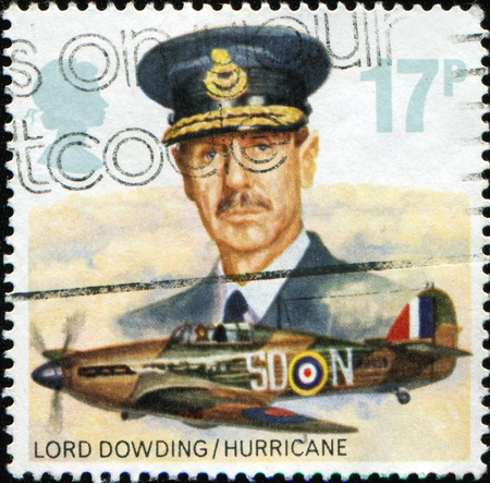 royal air force: UNITED KINGDOM - CIRCA 1986: A stamp printed in the United Kingdom shows Lord Dowding and Hawker Hurricane Mk. I from Royal Air Force, circa 1986 Editorial
