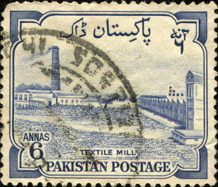 PAKISTAN - CIRCA 1955: A stamp printed in Pakistan shows Textile mill, circa 1955 Stock Photo - 10033324