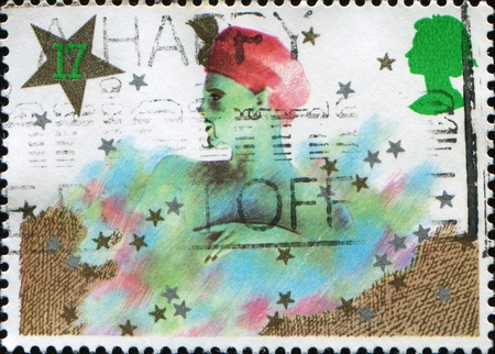 pantomima: REINO UNIDO - CIRCA 1985: Un sello impreso en el Reino Unido muestra Genie Navidad. Personajes pantomima, alrededor de 1985.