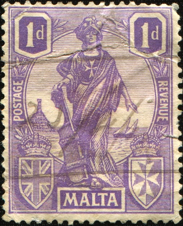 MALTA - CIRCA 1922: A stamp printed in Malta shows Mylitta (Mylitta is Assyrian and Babylonian goddess of fertility, love, war, and sex - simbol of Malta), circa 1922  photo