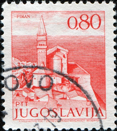 YUGOSLAVIA - CIRCA 1971: A stamp printed in Yugoslavia shows View at Piran in Slovenia at the Adriatic sea , circa 1971 Stock Photo - 10258450