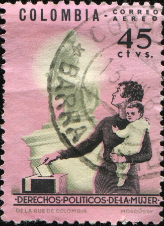 COLOMBIA - CIRCA 1962: A stamp printed in Colombia honoring Womens Franchise shows Mother Voting and Statue of Policarpa Salavarrieta , circa 1962  photo