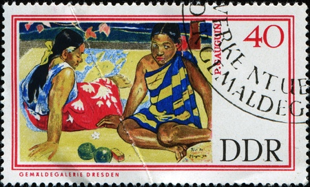 GERMAN DEMOCRATIC REPUBLIC - CIRCA 1967: A stamp printed in GDR (East Germany) shows Tahitian Women on the Beach by Paul Gauguin, circa 1967