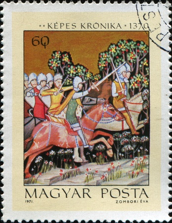 cancelled stamp: HUNGARY - CIRCA 1971: A spamp printed in Hungary shows Miniatures from the Illuminated Chronicle of King Lajos I of Hungary. The Pursuit of King Peter, circa 1971