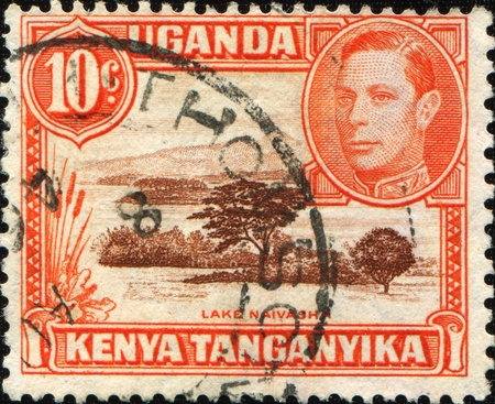KENYA, UGANDA AND TANGANYIKA - CIRCA 1938: A stamp printed in East Africa shows lake Naivasha, circa 1938 Stock Photo - 10314481
