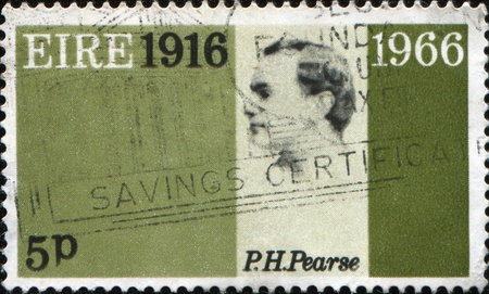 martyrdom: IRELAND (EIRE) - CIRCA 1966: mail stamp printed in Eire commemorating revolution martyr Patrick Pearse and fifty years of political unrest in Ireland, circa 1966