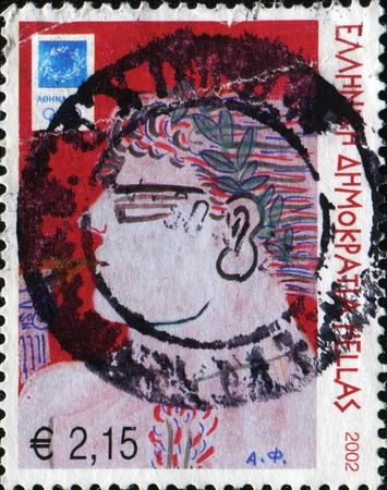 GREECE - CIRCA 2002: A stamp printed in Greece shows olimpionik - winner of the ancient Greek Olympic Games, circa 2002
