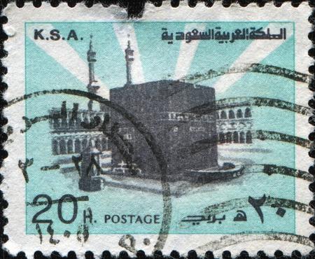 ksa: SAUDI ARABIA - CIRCA 1976: A stamp printed in The Kingdom of Saudi Arabia (K.S.A.) shows sacred place of Muslims Kaaba in Mecca, circa 1976  Stock Photo