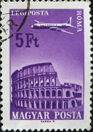 HUNGARY - CIRCA 1966: A stamp printed in Hungary shows airplane and colosseum, circa 1966 photo