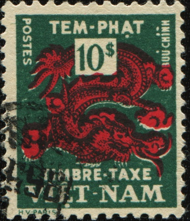 SOUTH VIETNAM - CIRCA 1955: A stamp printed in South Vietnam shows Red Dragon, circa 1955 photo