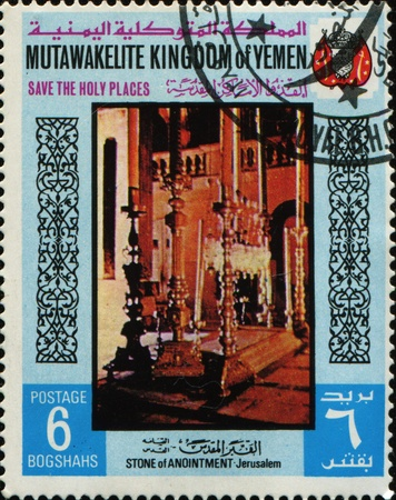 KINGDOM OF YEMEN - CIRCA 1969: A stamp printed in the Kingdom of Yemen shows Stone of Anointment, Jerusalem, circa 1969 Stock Photo - 10415460