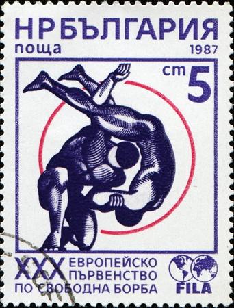 BULGARIA - CIRCA 1987: A stamp printed in Bulgaria shows wrestling, circa 1987 photo