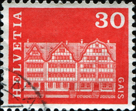 perforated stamp: SWITZERLAND - CIRCA 1968: A stamp printed in Switzerland shows a gabled house from Gais in the canton of Appenzell Ausserrhoden, circa 1968  Stock Photo