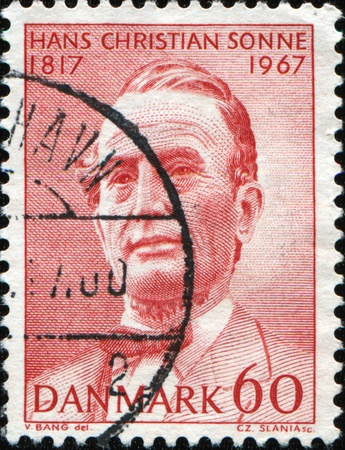 theologian: DENMARK - CIRCA 1967: A stamp printed in Denmark shows Hans Christian Sonne was a Danish theologian, Archdeacon, circa 1967