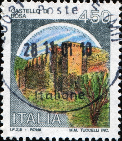 ITALY - CIRCA 1980: A Stamp printed in the Italy shows castel di Bosa, circa 1980 Stock Photo - 10458299