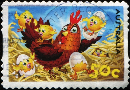 hatched: AUSTRALIA - CIRCA 2006: A greeting Easter stamp printed in Australia shows chicken with just hatched from the eggs of chickens, circa 2006