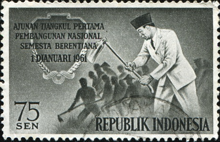sukarno: INDONESIA - CIRCAA 1961: A stamp printed in Indonesia honoring  National Development Plan, shows President Sukarno and Workers Hoeing, circa 1961