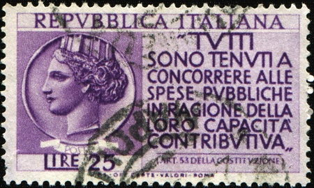 ITALY - CIRCA 1953: A tax stamp printed in Italy shows  Coin of Syracuse,