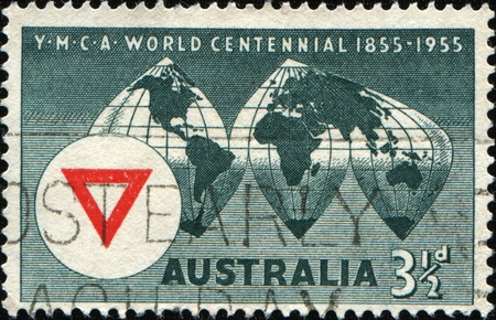 AUSTRALIA - CIRCA 1955: A stamp printed in Australia, shows the World Map, YMCA (Young Mens Christian Association)  Emblem, circa 1955  photo